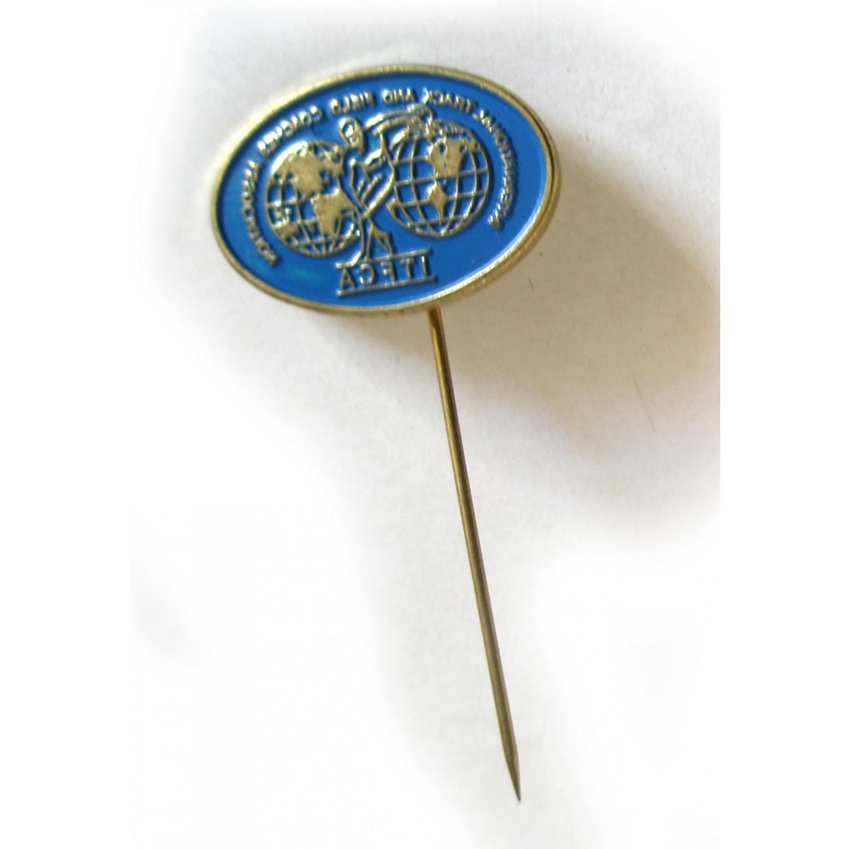 Καρφίτσα της Διεθνούς Ένωσης  Προπονητών Στίβου.