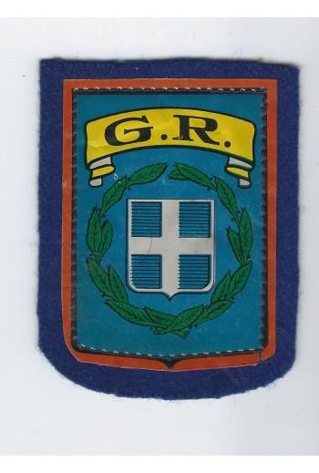 Σήμα GR ραφτό σε τσόχα.